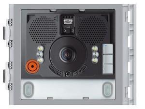 """Di adiós a las zonas muertas en los sistemas de videoportero con el módulo audio-vídeo de gran angular para placas Sfera New de Tegui, que permite realizar sistemas de vídeo en color de dos hilos. El conjunto está dotado de una telecámara en color con sensor de 1/3"""" y leds blancos para iluminar el campo de filmación, un sistema que permite obtener un mayor ángulo de visión que los sistemas tradicionales, permitiendo al usuario tener un mejor control de quien llama desde la placa. Además de su mayor ángulo de imagen, el módulo cuenta con prestaciones adicionales como una resistencia de precalentamiento antivaho o la posibilidad de regular el volumen del altavoz y el micrófono. El módulo gran angular para Sfera New de Tegui gestiona hasta un máximo de 98 llamadas a pulsadores, utilizando para ello módulos adicionales de pulsadores en dos hileras. También permite abrir una electrocerradura conectada directamente a bornes S+ y S- (18V 4A impulsivos - 250 mA mantenimiento en 30Ohm máx) y la conexión de un pulsador de abrepuerta local en los bornes PL. Configurado para alimentación adicional, está dotado de leds frontales para señalizar el estado de funcionamiento (abrepuerta, comunicación activada, llamada enviada y sistema ocupado) y dispone de un sensor óptico incorporado para encender la retroiluminación nocturna. Integrable con frontal de acabado, el dispositivo de gran angular debe configurarse físicamente o mediante el uso de un PC con el software TiSferaDesign."""
